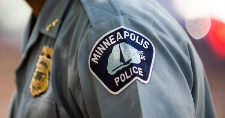 A Minneapolis police officer with his shoulder insignia displayed.