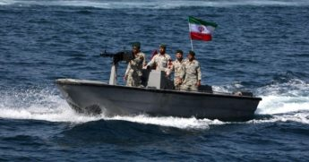 "Iranian soldiers aboard a gun boat take part in a ""National Persian Gulf Day"" ceremony in the Strait of Hormuz in an April 2019 file photo."