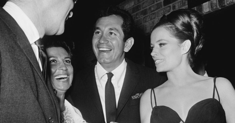 Singer and actor Trini Lopez with singer Nancy Sinatra, left, and actress Luciana Paluzzi, right, in a photo circa 1970.