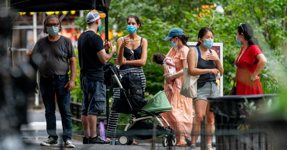 People wear masks in Madison Square Park in New York City on Aug. 12, 2020, during the fourth phase of reopening in the city. Far away, in Hawaii, the news on the spread of the coronavirus hasn't been good.