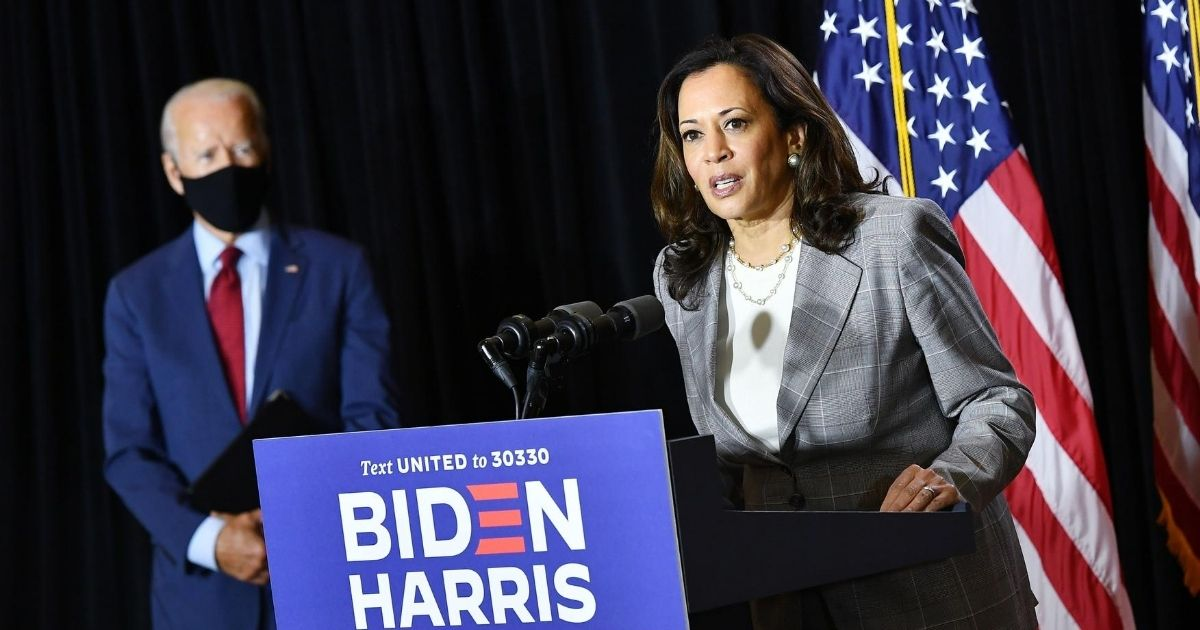 Democratic presidential nominee former Vice President Joe Biden, left, and his running mate, California Sen. Kamala Harris, hold a news conference after receiving a briefing on COVID-19 in Wilmington, Delaware, on Aug. 13, 2020.