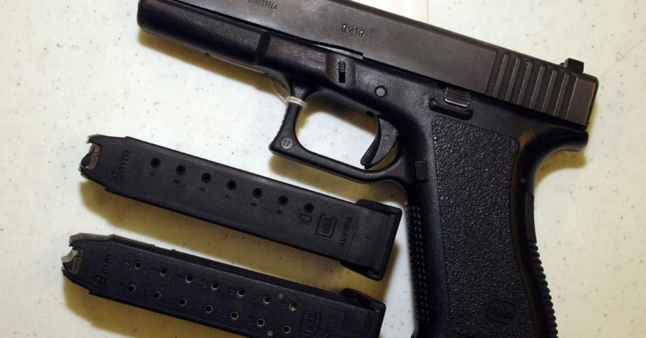 A Glock 9mm pistol is displayed with two different capacity bullet clips at Shooters USA target range in Bossier City, Louisiana, on Sept. 11, 2004.