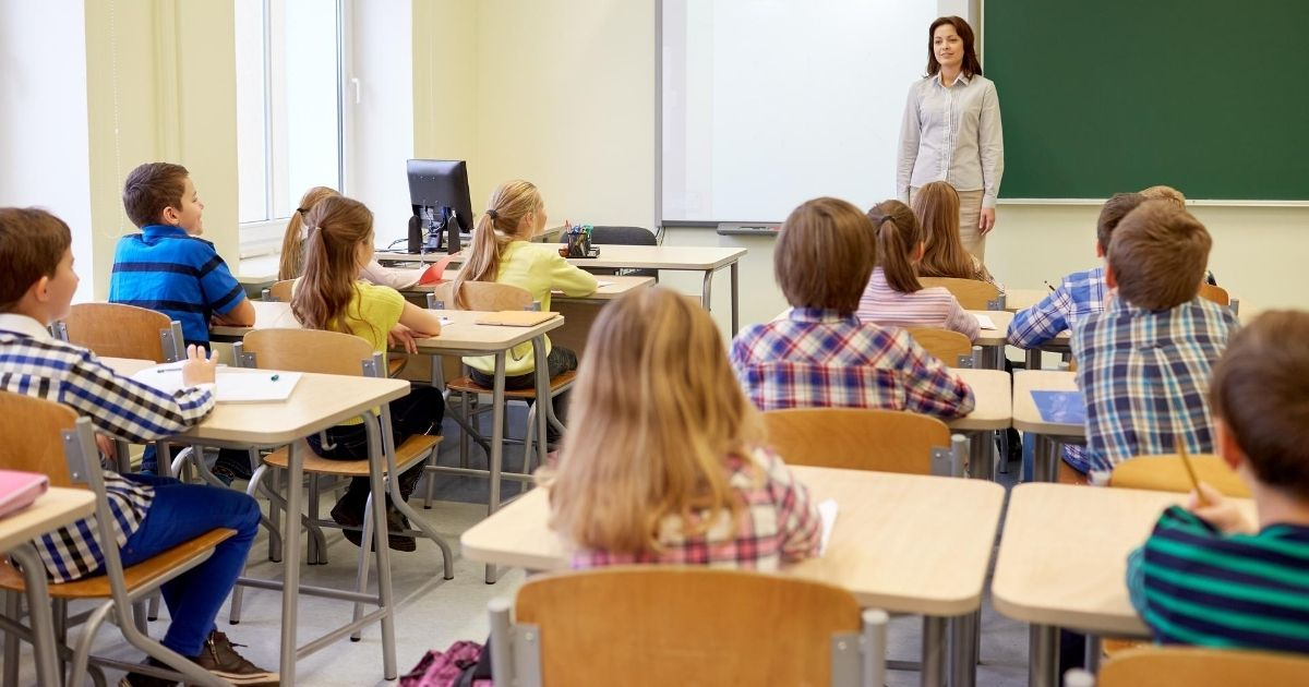 A stock image of an elementary classroom full of students is pictured above.