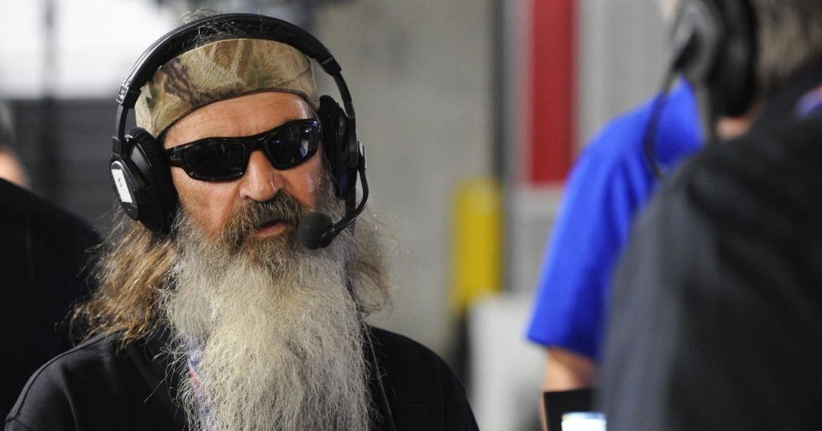 Reality TV star Phil Robertson talks with Steve Bannon on Breitbart News Daily on SiriusXM Patriot at the Quicken Loans Arena on July 21, 2016, in Cleveland.