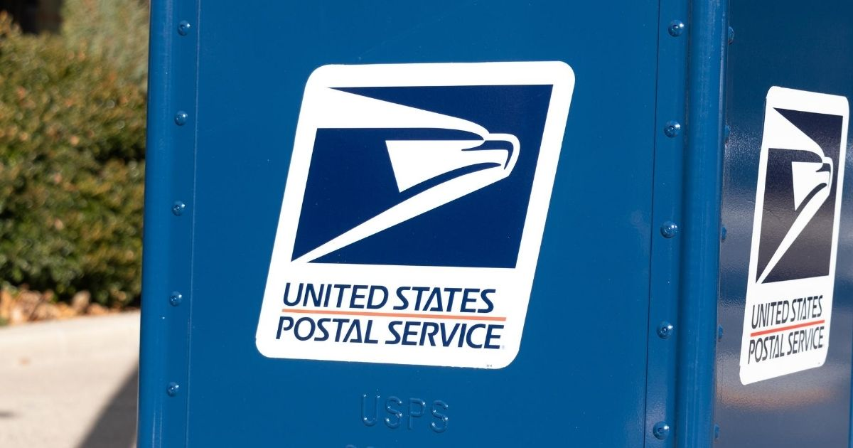 A United States Postal Service logo is pictured on the side of a dropbox in Washington, D.C.