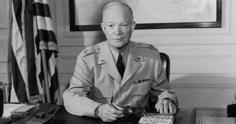 Former President Dwight D. Eisenhower, then the supreme Allied commander, sits at his desk at headquarters.