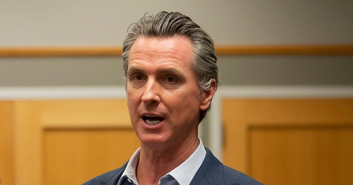 California Gov. Gavin Newsom speaks during a tour of a cooling center with Sacramento Mayor Darrell Steinberg at the Tsakopoulos Library Galleria on Aug. 18, 2020, in Sacramento, California.