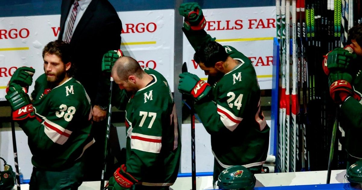 Matt Dumba of the Minnesota Wild raises his fist before a game against the Vancouver Canucks on Aug. 7, 2020. Dumba has either kneeled or stood during the anthem. On Aug. 1, he became the first NHL player to kneel.