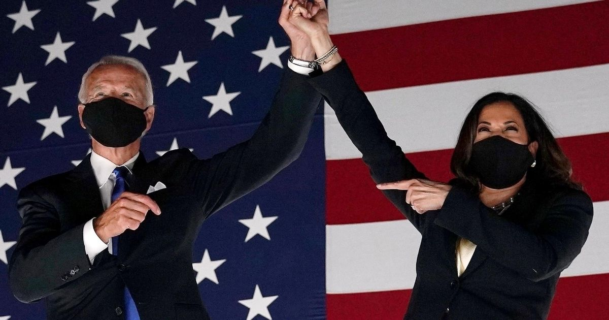 Democratic presidential nominee Joe Biden and his running mate, Sen. Kamala Harris, present a united front for supporters outside the Chase Center in Wilmington, Delaware, at the conclusion of the Democratic National Convention on Aug. 20, 2020.