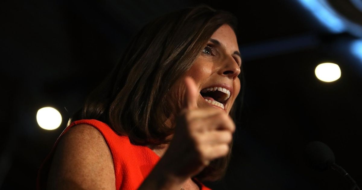 Republican Sen. Martha McSally of Arizona, then a congresswoman for the state's 2nd Congressional District, speaks on Aug. 28, 2018, in Tempe, Arizona.