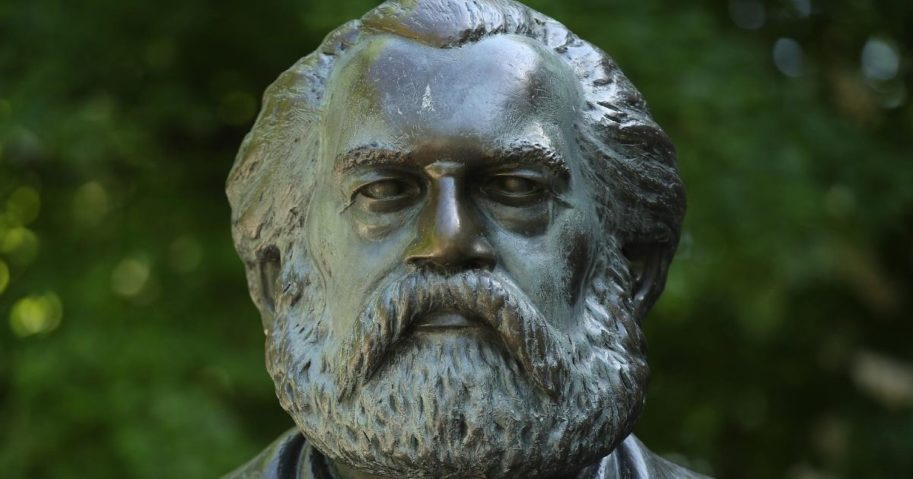 A statue of philosopher and revolutionary Karl Marx stands in a public park on May 4, 2018, in Berlin.