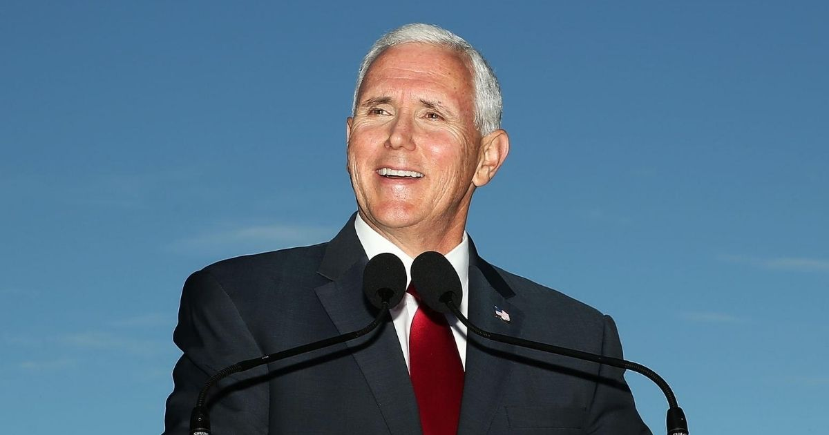 Vice President Mike Pence laughs during a media conference at Kirribilli House on April 22, 2017, in Sydney.