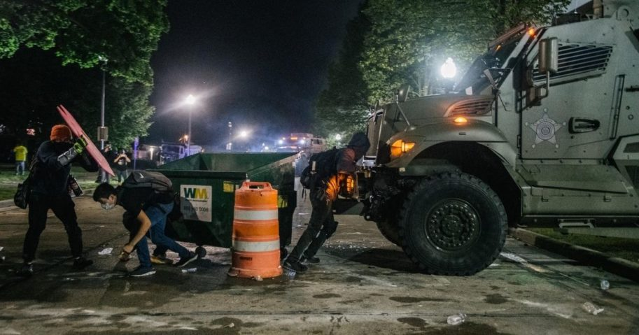 Demonstrators attempt to block an armored police vehicle on Aug. 25, 2020, in Kenosha, Wisconsin.