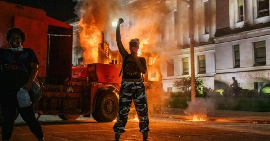 Demonstrators chant in front of a burning truck on Aug. 24, 2020 in Kenosha, Wisconsin.