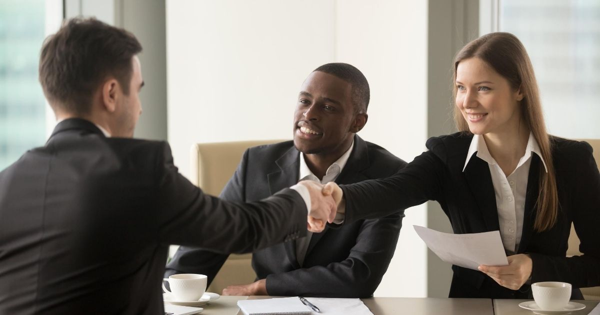 Candidates are interviewed for a job in the stock photo above.
