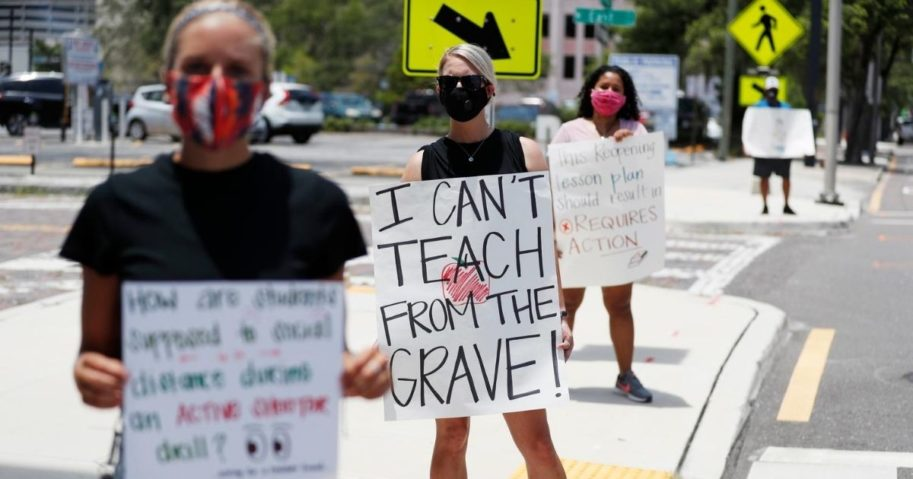 Teachers protest in front of the Hillsborough County School District Office on July 16, 2020, in Tampa, Florida. Teachers and administrators from the school system rallied against the reopening of schools due to health and safety concerns amid the COVID-19 pandemic.