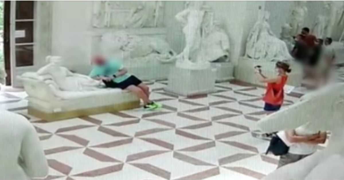 An Austrian tourist accidentally broke off two toes of a statue in his pursuit of the perfect photo and may be facing charges.