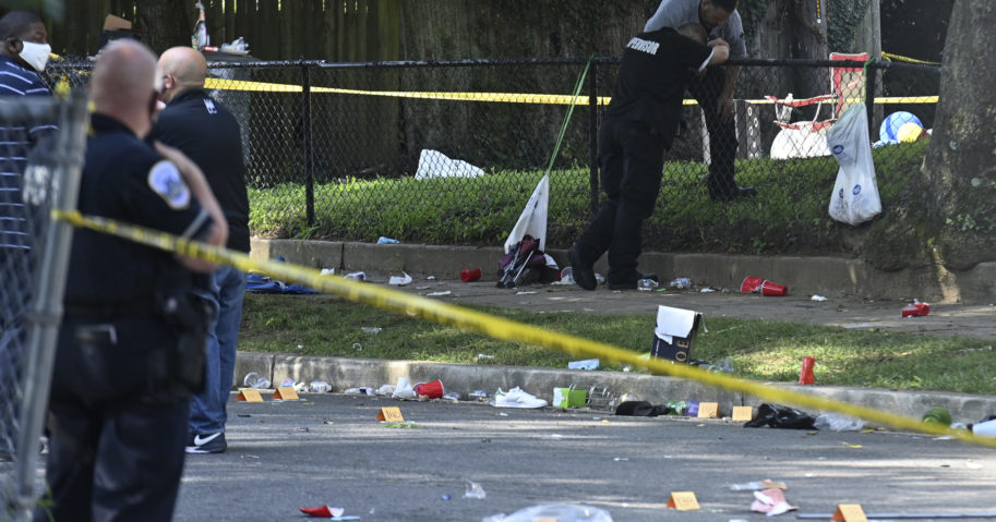 Authorities investigate the scene in Washington, D.C., after a shooting left one dead and 20 wounded on Aug. 9, 2020.