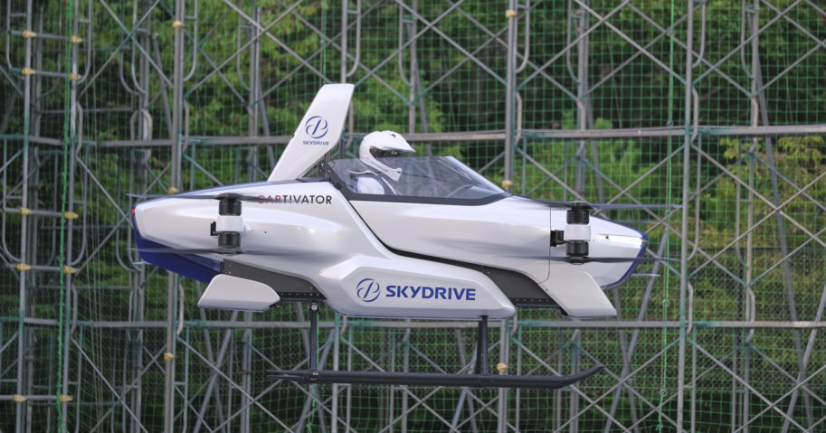 """This August 2020 photo released by SkyDrive/CARTIVATOR shows a test flight of a manned """"flying car"""" at Toyota Test Field in Toyota, central Japan. Japan's SkyDrive Inc. has carried out a successful though modest test flight with one person aboard."""