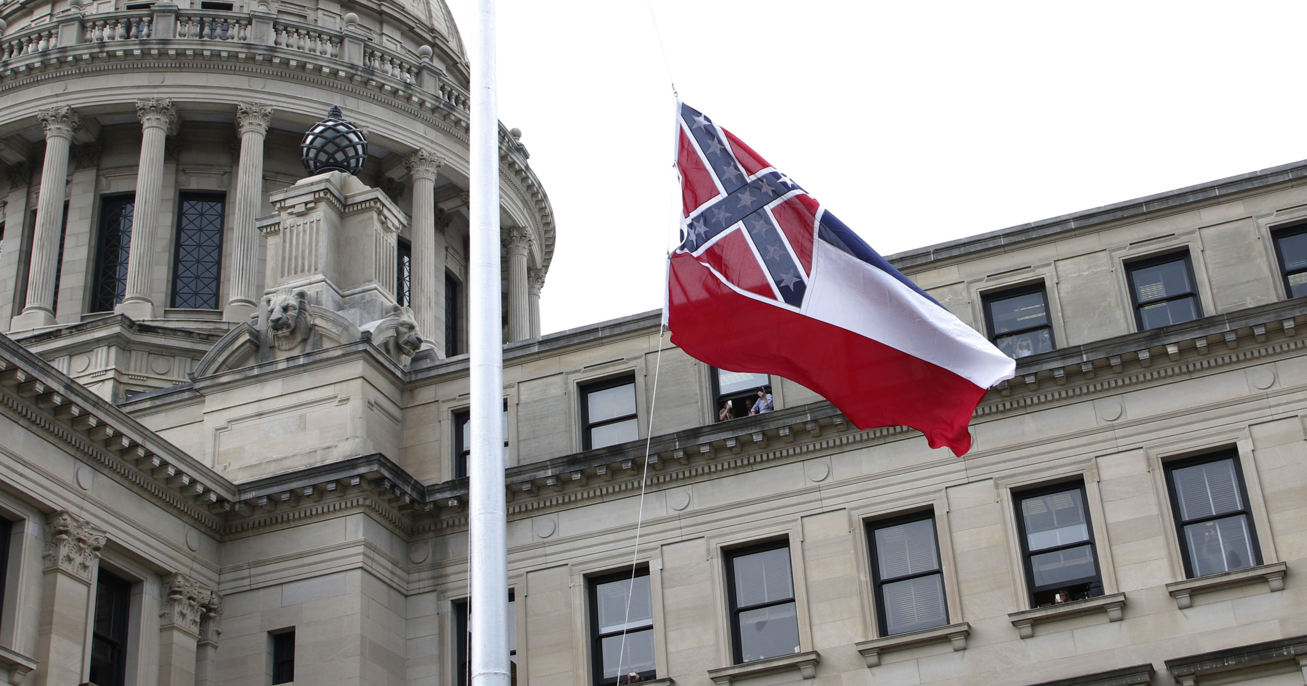 The retired Mississippi state flag is raised over the Capitol grounds one final time in Jackson, Mississippi, on July 1, 2020.