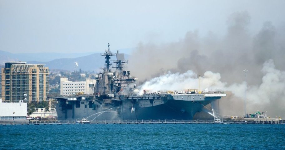Port of San Diego Harbor Police Department boats combat a fire aboard the amphibious assault ship USS Bonhomme Richard at Naval Base San Diego on July 12, 2020.