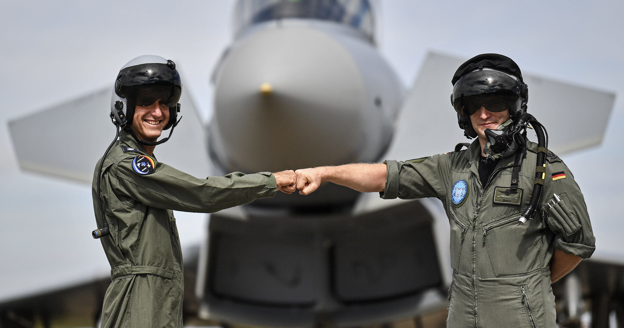 A pilot from Israel, left, and a pilot from Germany, right, pose in front of a Eurofighter at an airbase in Noervenich, Germany, on Aug. 20, 2020. Pilots from Israel and Germany will fly together over the next two weeks during the first joint military air exercises between the two nations.