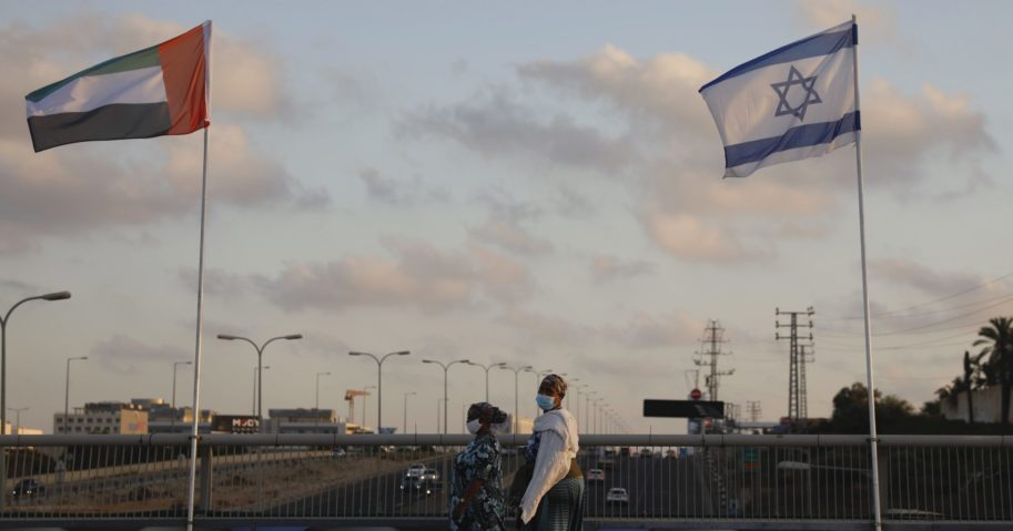 Women walk past United Arab Emirates and Israeli flags at the Peace Bridge in Netanya, Israel, on Aug. 16, 2020. The UAE flag was displayed to celebrate last week's announcement that Israel and the United Arab Emirates have agreed to establish full diplomatic relations.
