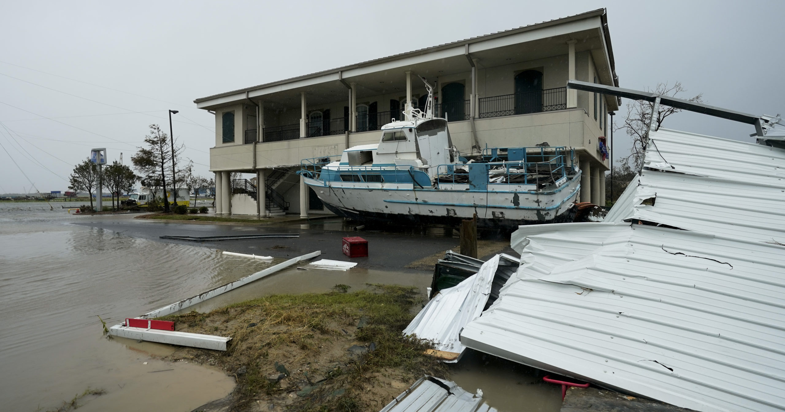 Flooding surrounds a damaged building and boat on Aug. 28, 2020, in Cameron, Louisiana, after Hurricane Laura moved through the area.