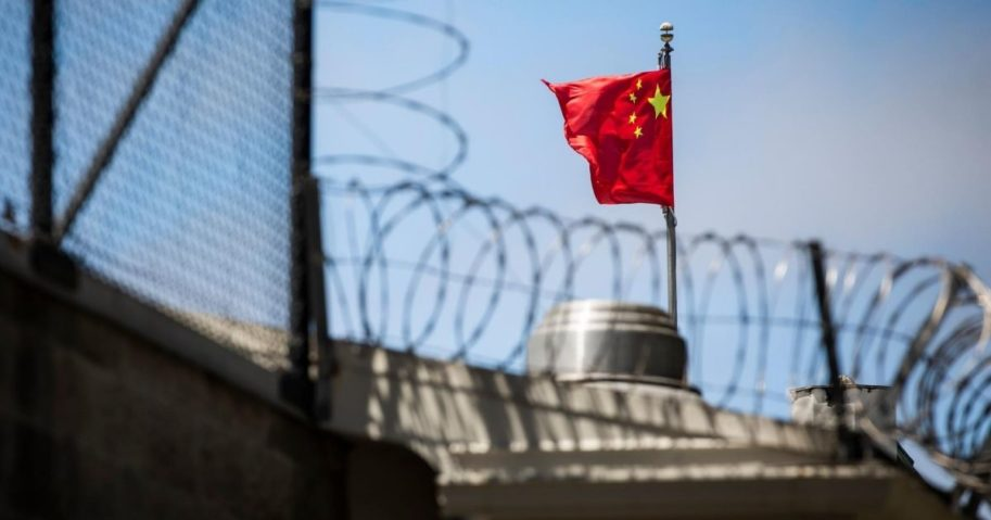 The Chinese flag flies behind barbed wire at the Chinese consulate in San Francisco, California, on July 23, 2020.