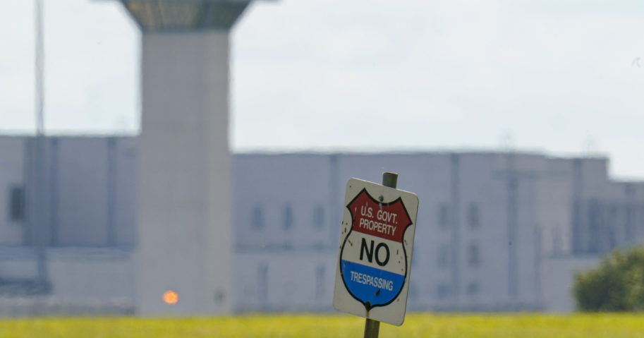A sign stands in front the federal prison complex in Terre Haute, Indiana, on Aug. 26, 2020.