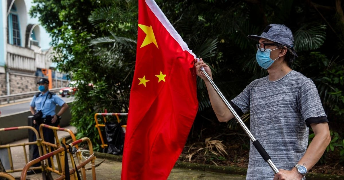 A pro-China protester demonstrates outside the US consulate in Hong Kong on Aug. 8, 2020, after the US applied sanctions to Hong Kong Chief Executive Carrie Lam and other top officials in response to Beijing enacting a national security law on the city.