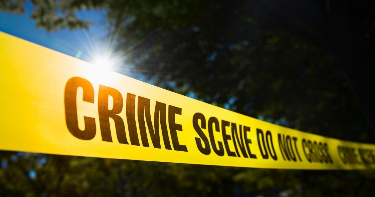 The above stock image shows tape surrounding a crime scene.