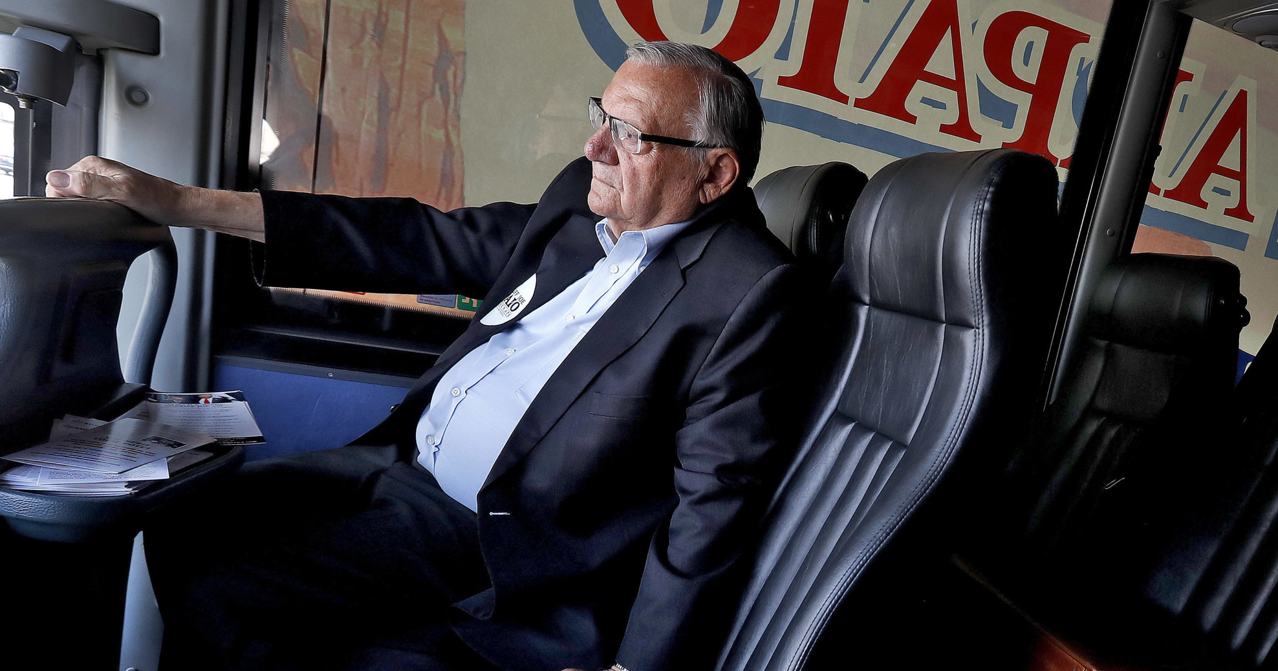 In this Aug. 23, 2018, file photo, U.S. Senate candidate and former Maricopa County Sheriff Joe Arpaio rides on his campaign bus in Phoenix. Arpaio's primary defeat in his bid to win back the sheriff's post in metro Phoenix marks the end of what's likely to be the 88-year-old lawman's last political campaign.