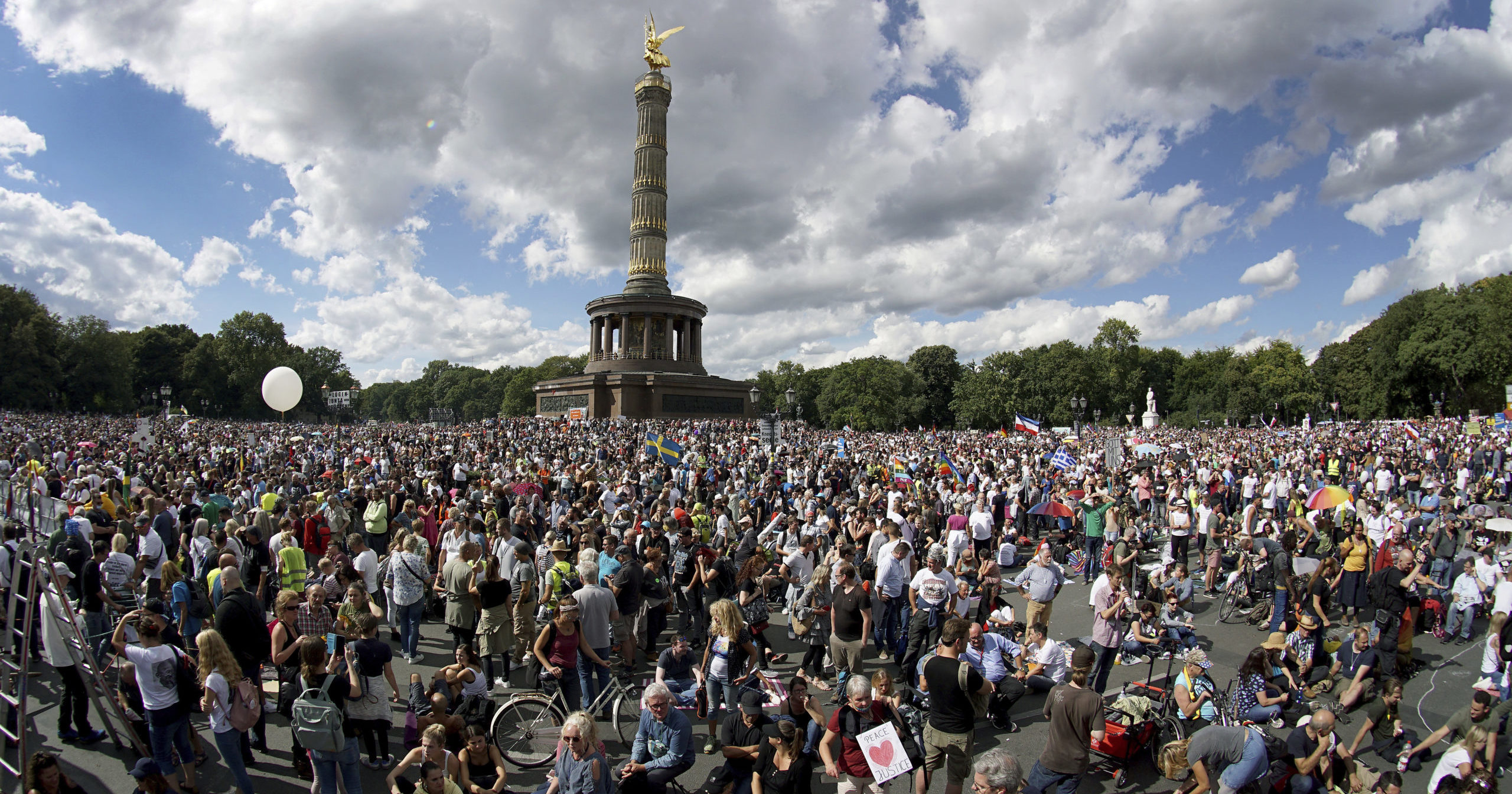 People attend a protest in Berlin, Germany, on Aug. 29, 2020, against new coronavirus restrictions in Germany.