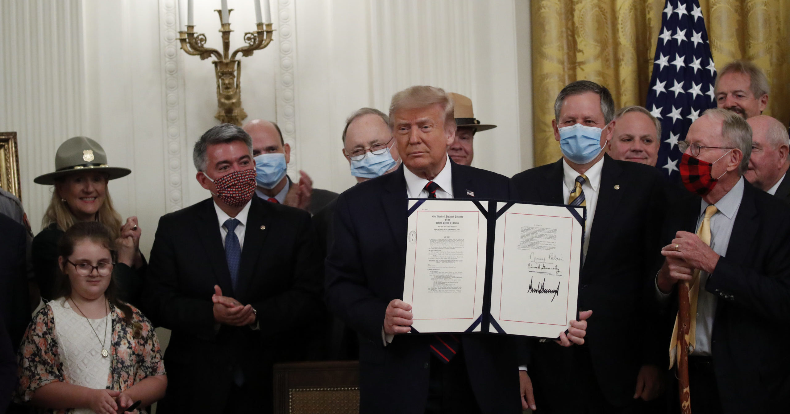 President Donald Trump poses for a photo during a signing ceremony for the Great American Outdoors Act in the East Room of the White House on Aug. 4, 2020, in Washington, D.C.