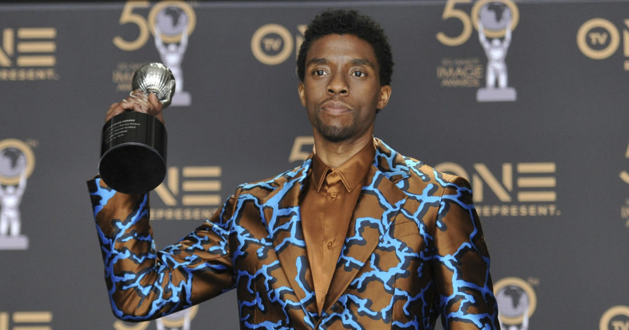 "In this March 30, 2019, file photo, Chadwick Boseman poses in the media room with the award for outstanding actor in a motion picture for ""Black Panther"" at the 50th annual NAACP Image Awards at the Dolby Theatre in Los Angeles."