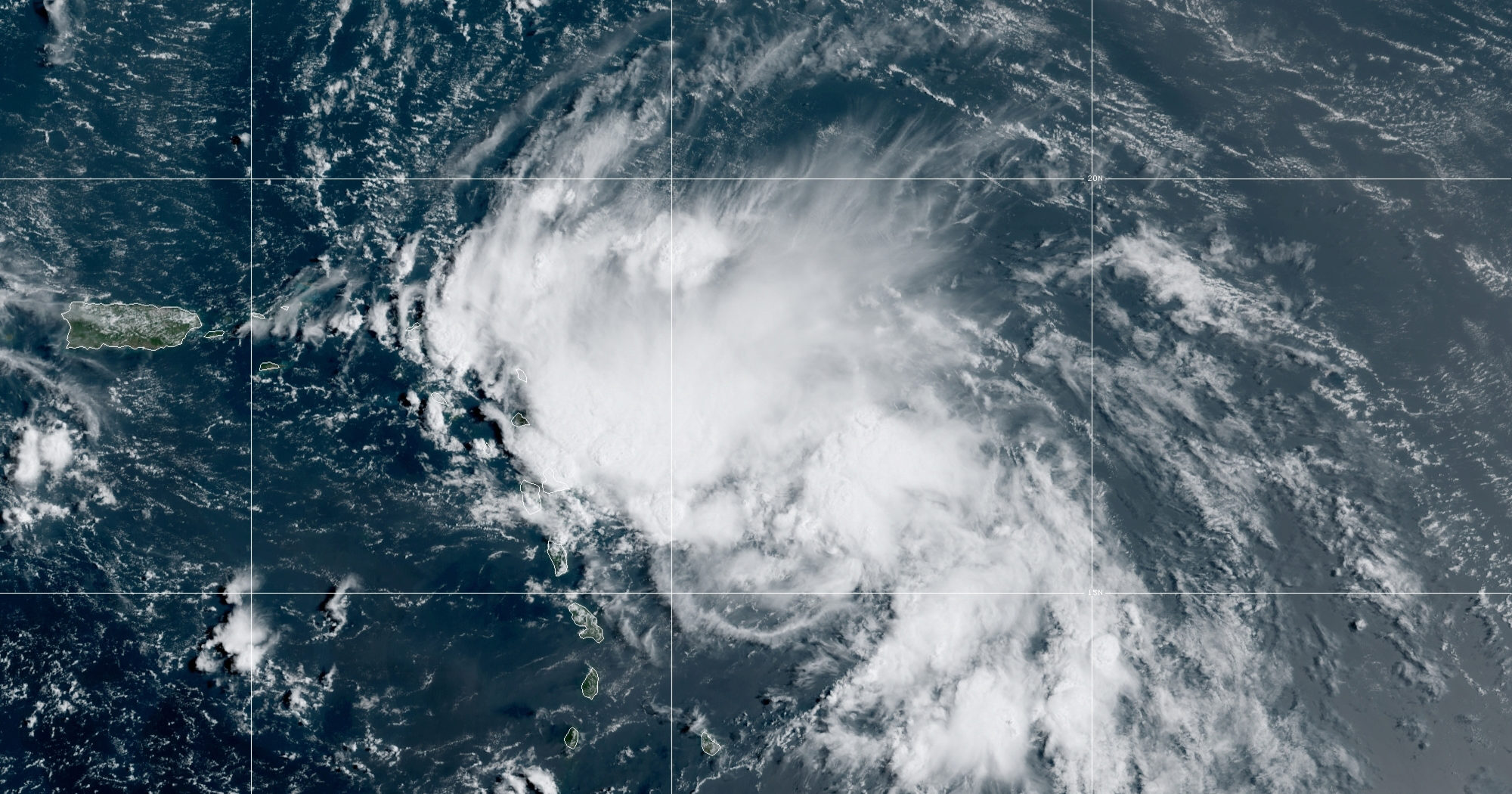 This satellite image released by the National Oceanic and Atmospheric Administration shows Tropical Storm Laura in the Atlantic Ocean on Aug. 21, 2020. Laura formed Friday in the eastern Caribbean and forecasters said it poses a potential hurricane threat to Florida and the U.S. Gulf Coast. A second storm also may hit the U.S. after running into Mexico's Yucatan Peninsula.