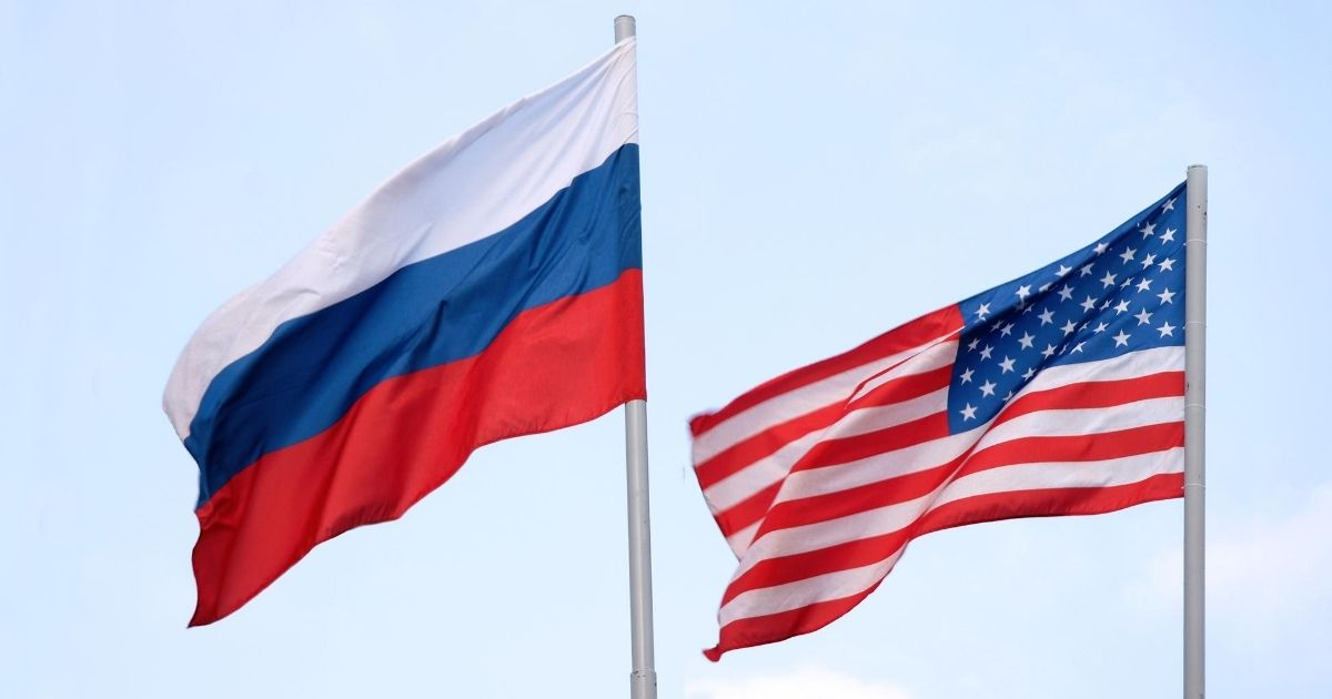 The Russian flag waves alongside the American in this stock image.