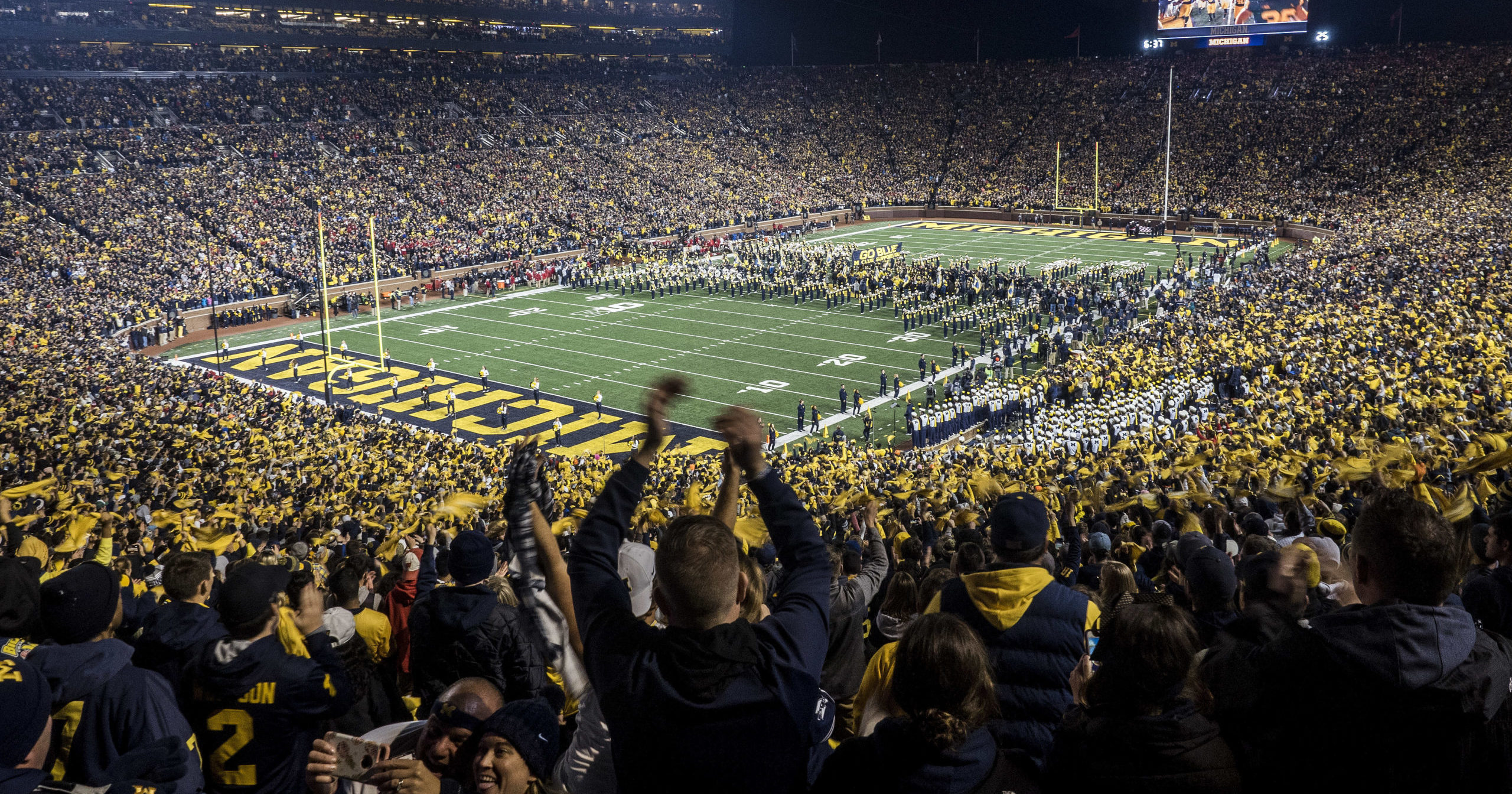 Fans cheer as Michigan takes the field at Michigan Stadium for an NCAA football game against Wisconsin in Ann Arbor, Michigan, on Oct. 13, 2018.