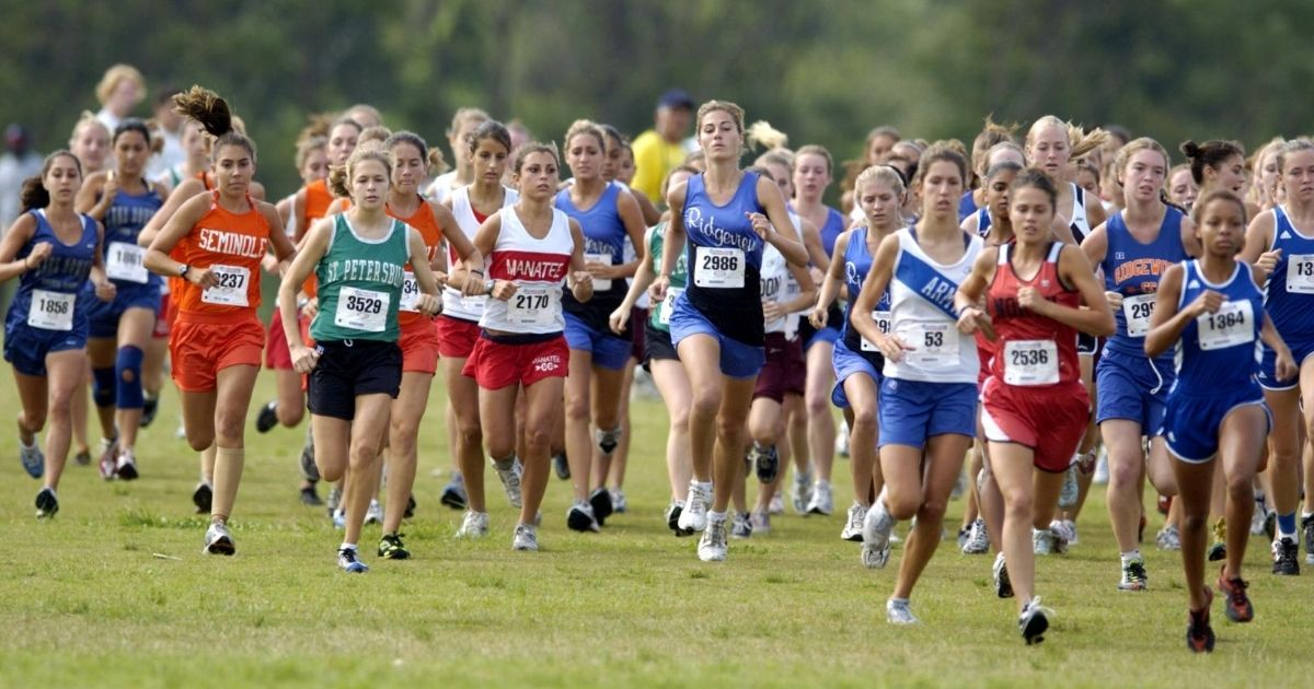 Girls compete in a cross country race in this stock image.