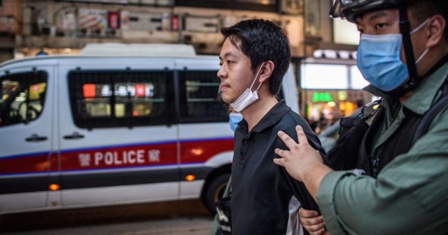 Pro-democracy legislator Ted Hui is detained by police during a pro-democracy rally in Hong Kong on June 12, 2020.
