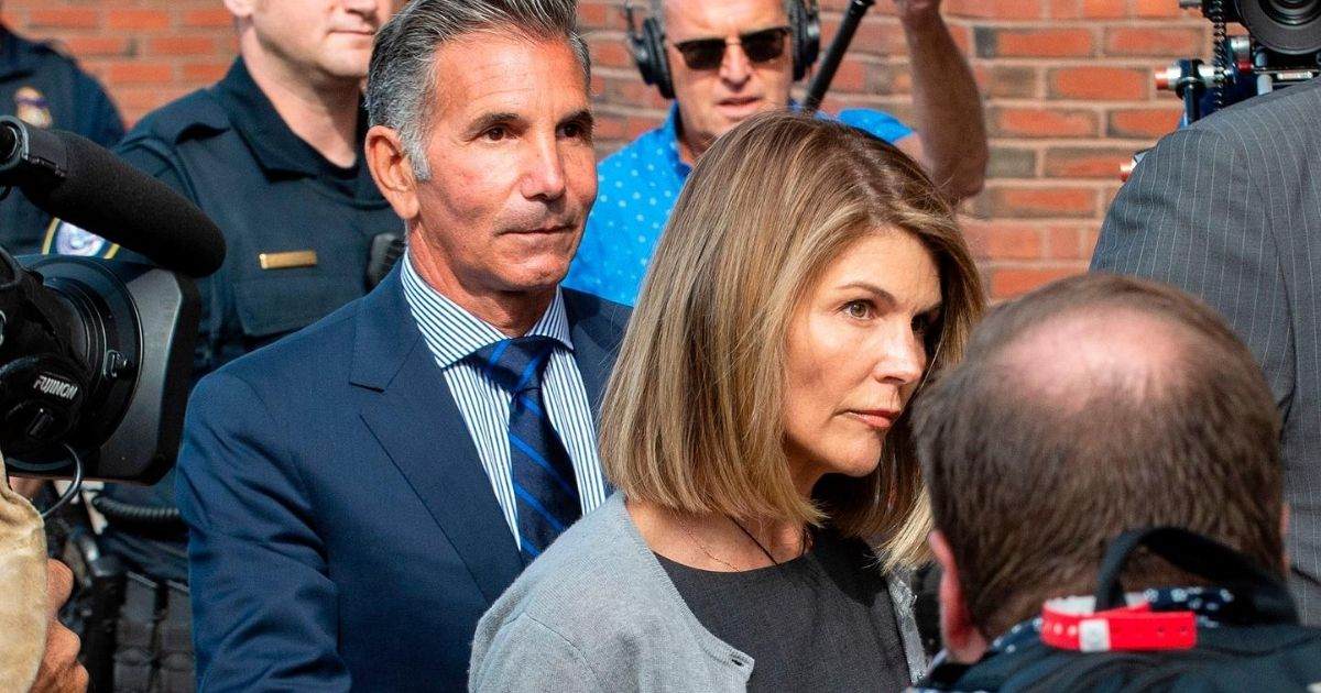 Actress Lori Loughlin and husband Mossimo Giannulli exit a federal courthouse in Boston after a pre-trial hearing on Aug. 27, 2019. Loughlin and Giannulli pleaded guilty in May 2020 in a college admissions scam and were sentenced on Aug. 21.