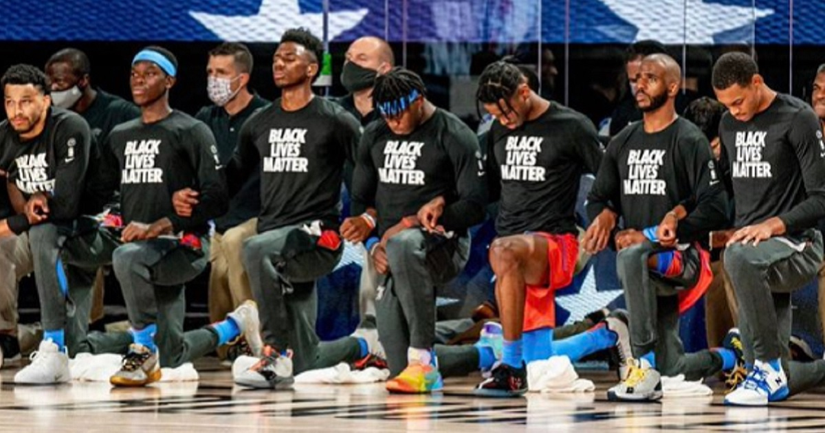 """Players for the Oklahoma City Thunder kneel during """"The Star-Spangled Banner."""""""