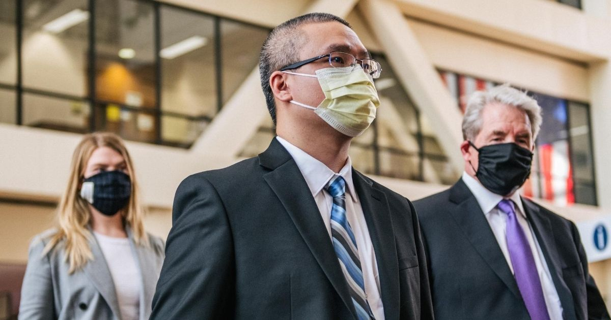 Former Minneapolis police officer Tou Thao and his attorney Earl Gray exit the Hennepin County Government Center after a courthouse appearance on July 21, 2020, in Minneapolis, Minnesota. Thao is charged with aiding and abetting second-degree manslaughter in the death of George Floyd.