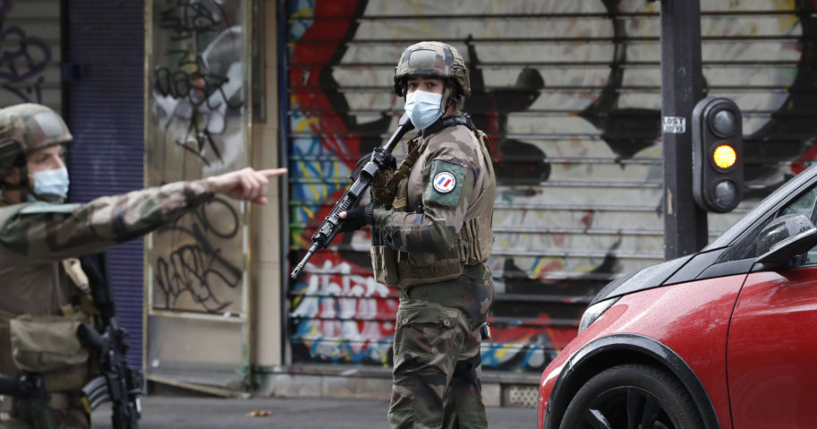French soldiers patrol after a knife attack near the former offices of satirical newspaper Charlie Hebdo on Sept. 25, 2020, in Paris.