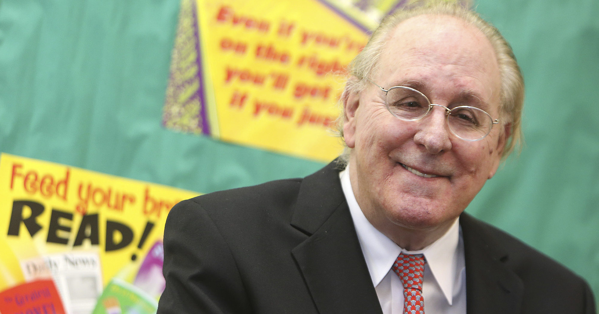 """In this April 29, 2016, file photo, """"Forrest Gump"""" author Winston Groom speaks to students at Jinks Middle School in Panama City, Florida. Groom, the author of the novel """"Forrest Gump"""" that was made into a six-Oscar winning 1994 movie, has died, an Alabama official close to the writer said on Sept. 17, 2020. He was 77."""