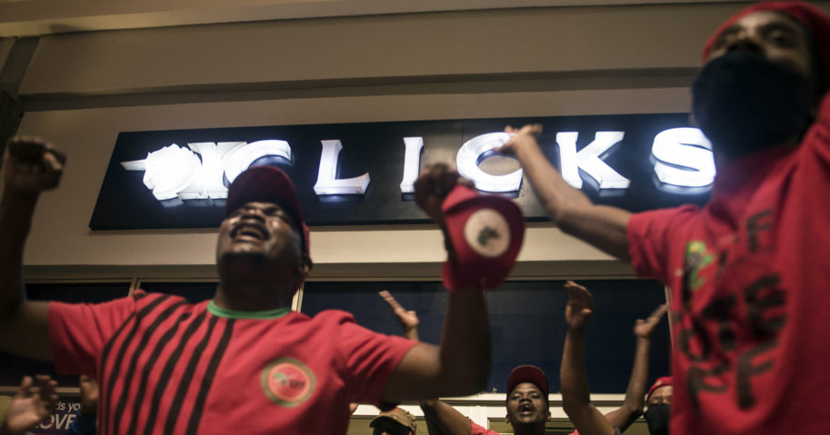 Economic Freedom Fighters supporters protest outside a Clicks store in Soweto, Johannesburg, on Sept. 7, 2020, calling for the closure of the stores around the country.