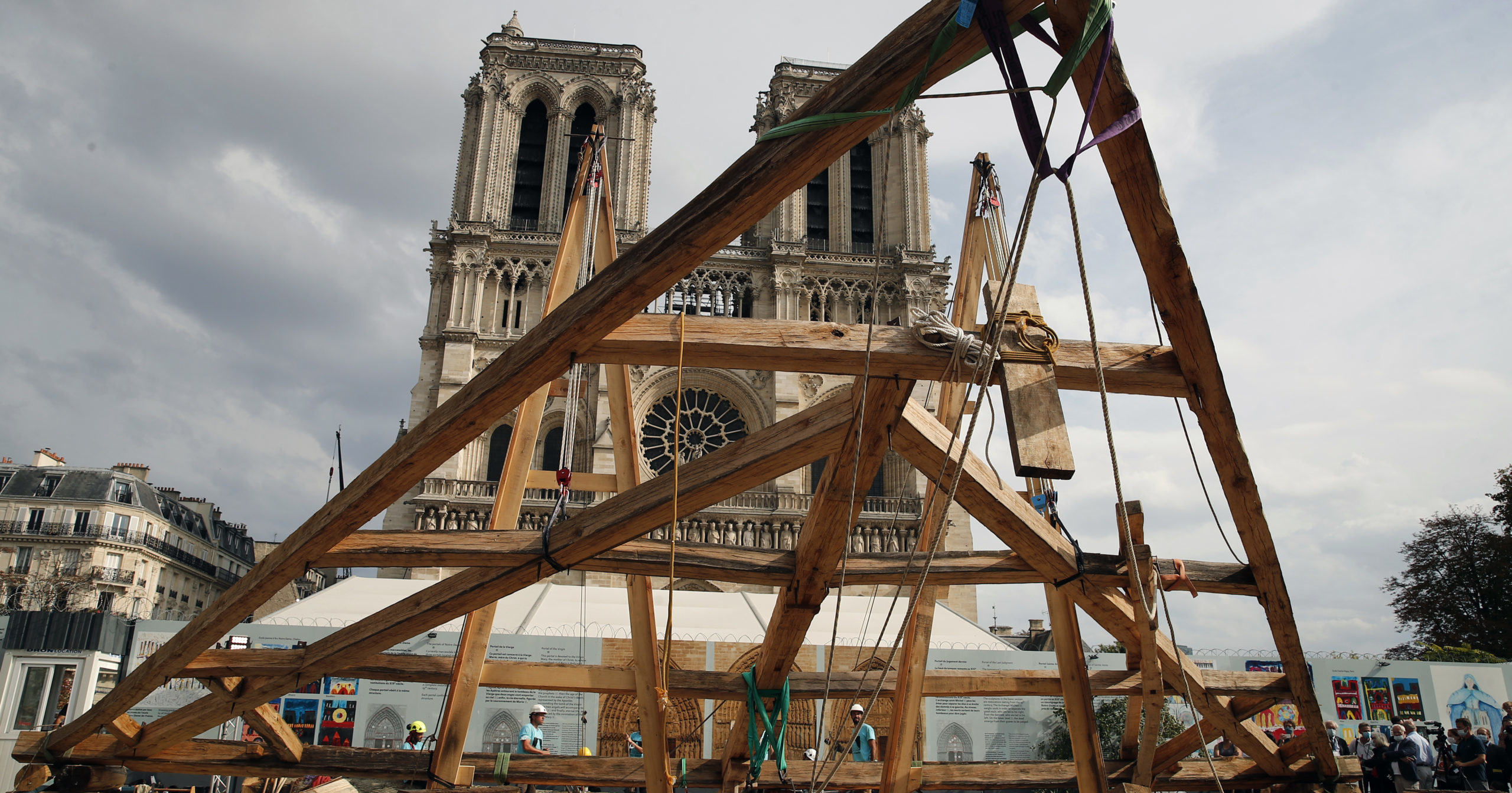 Carpenters work on the plaza in front of Notre Dame Cathedral in Paris on Sept. 19, 2020.