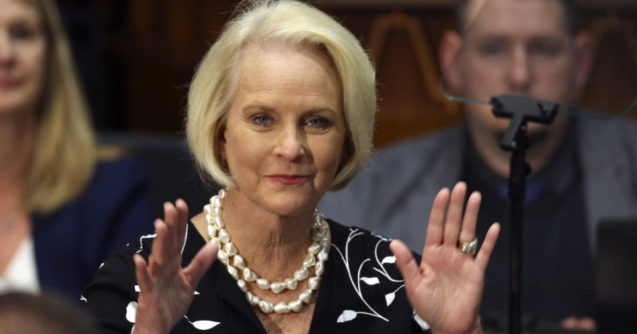 In this Jan. 13, 2020, file photo, Cindy McCain, wife of former Arizona Sen. John McCain, waves to the crowd after being acknowledged by Arizona Republican Gov. Doug Ducey during his State of the State address on the opening day of the legislative session at the Capitol in Phoenix.