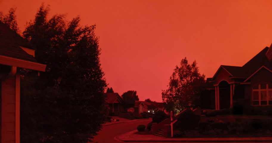 WildfiresThe sky appears red due to fires raging across the Pacific Northwest. are raging across the Pacific Northwest.
